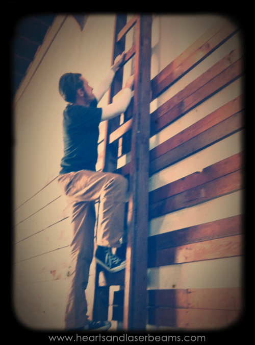 chris climbing ladder at crafted at the port of los angeles warehouse open house